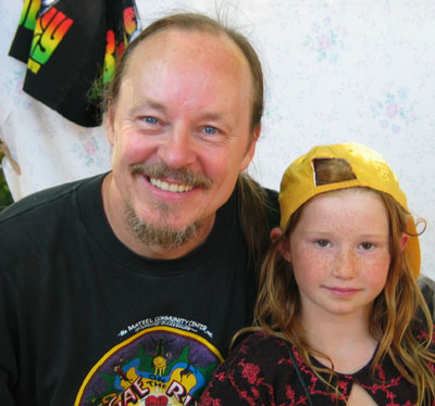Russel Wisby with student Ruby at Reggae on the River 2003